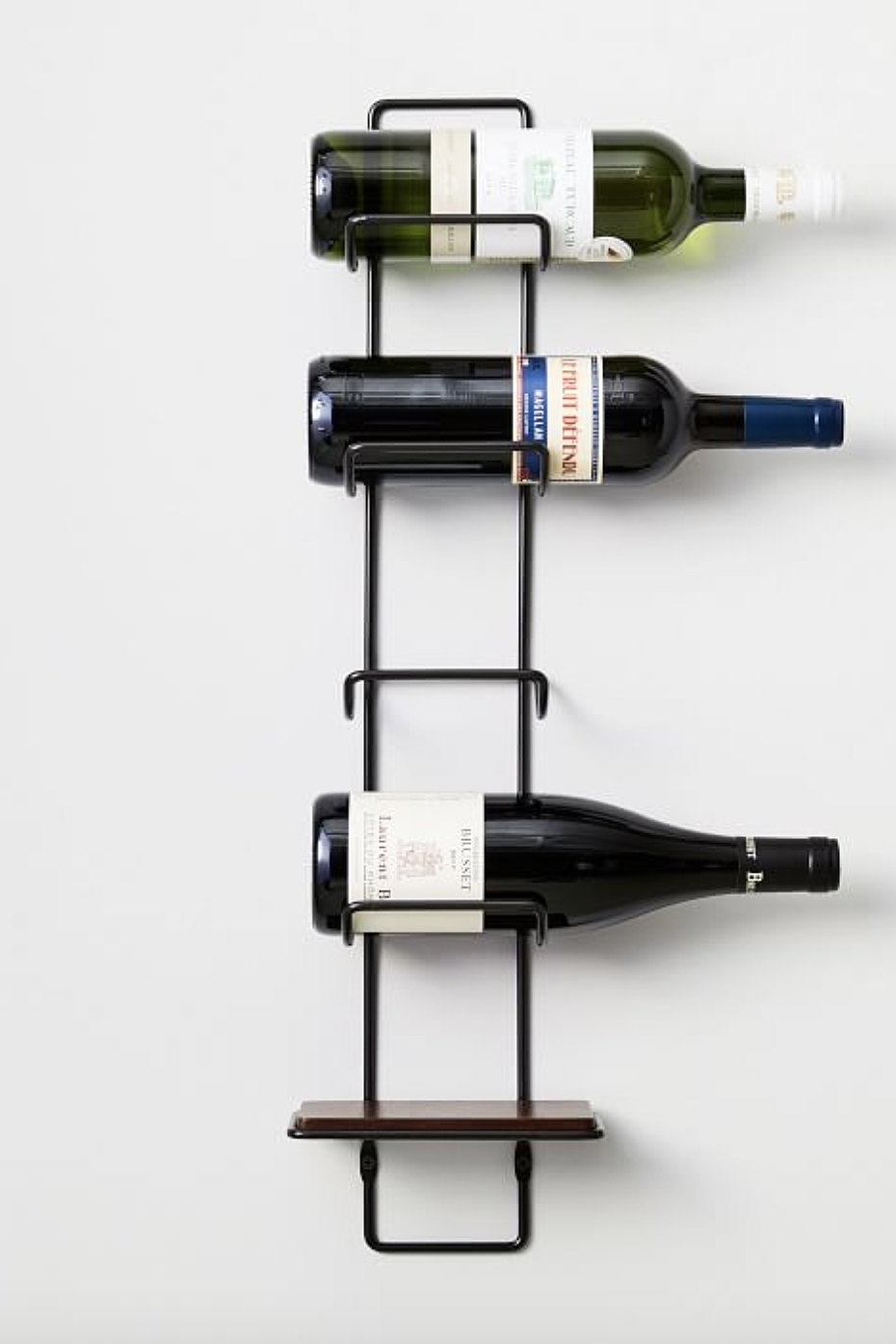 "<p>westelm.com</p><p><a href=""https://go.redirectingat.com?id=74968X1596630&url=https%3A%2F%2Fwww.westelm.com%2Fproducts%2Foutline-wine-rack-d6925&sref=https%3A%2F%2Fwww.delish.com%2Fkitchen-tools%2Fg32868715%2Fwine-racks%2F"" rel=""nofollow noopener"" target=""_blank"" data-ylk=""slk:CHECK PRICE"" class=""link rapid-noclick-resp"">CHECK PRICE</a></p><p>This sleek and modern wine rack holds up to five bottles of your favorite labels. Since the rack is narrow and can be mounted on a wall, it's great for small living spaces. The frame is made of steel while the mango wood used was sourced from tress that no longer produce fruit. </p>"