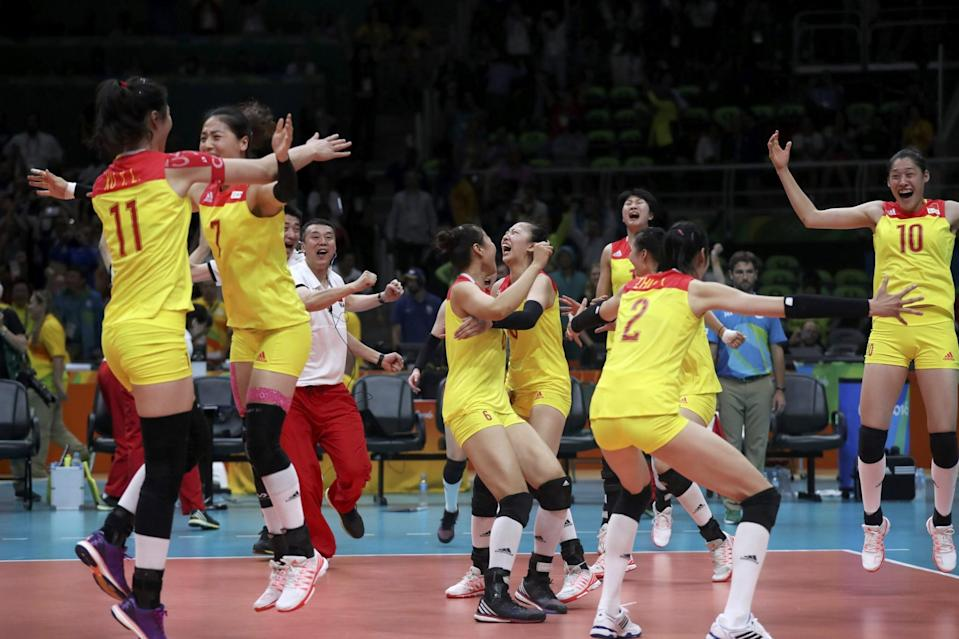 <p>China's players celebrate winning the match and the gold medal. REUTERS/Ricardo Moraes </p>
