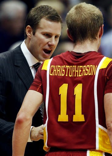 Iowa State coach Fred Hoiberg, left, talks with guard Scott Christopherson (11) during the first half of an NCAA college basketball game against Kansas in Lawrence, Kan., Saturday, Jan. 14, 2012. (AP Photo/Orlin Wagner)