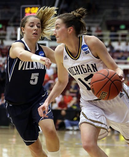 Michigan's Kate Thompson, right, drives the ball past Villanova's Caroline Coyer (5) during the first half of a first-round game in the women's NCAA college basketball tournament on Sunday, March 24, 2013, in Stanford, Calif. (AP Photo/Ben Margot)