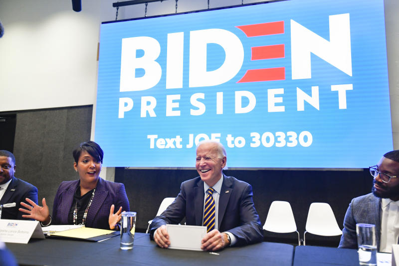 Former U.S. Vice President and 2020 Democratic presidential candidate Joe Biden reacts as he is introduced by Atlanta mayor Keisha Lance Bottoms during an assembly of Southern black mayors Thursday, Nov. 21, 2019 in Atlanta. (AP Photo/John Amis)