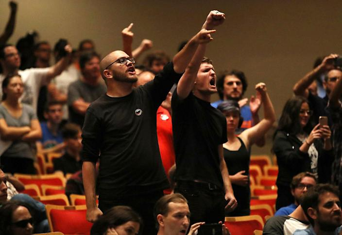 """<p>People react as white nationalist Richard Spencer, who popularized the term """"alt-right"""" speaks at the Curtis M. Phillips Center for the Performing Arts on Oct.19, 2017 in Gainesville, Fla. Spencer delivered a speech on the college campus his first since he and others participated in the """"Unite the Right"""" rally which turned violent in Charlottesville, Virginia. (Photo: Joe Raedle/Getty Images) </p>"""