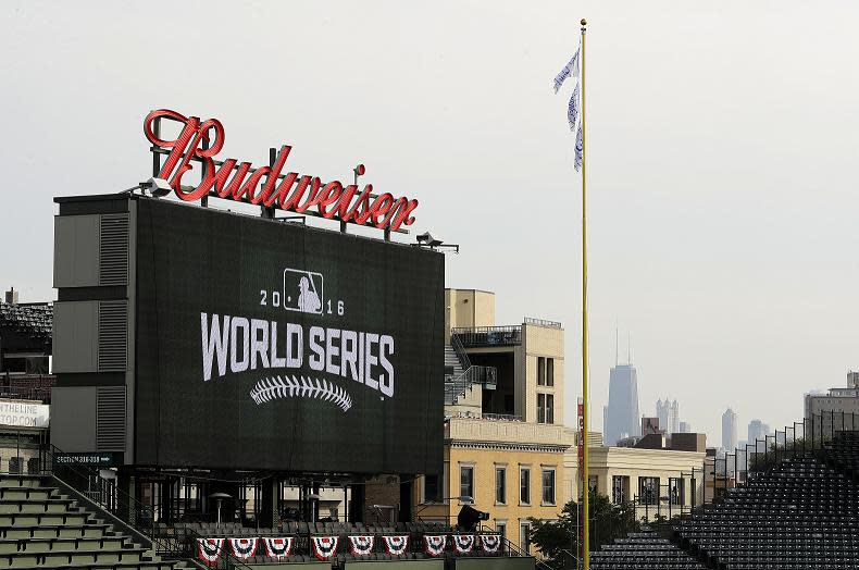 Downtown skyline is seen behind the scoreboard at Wrigley Field before Game 3 of the World Series. (AP)