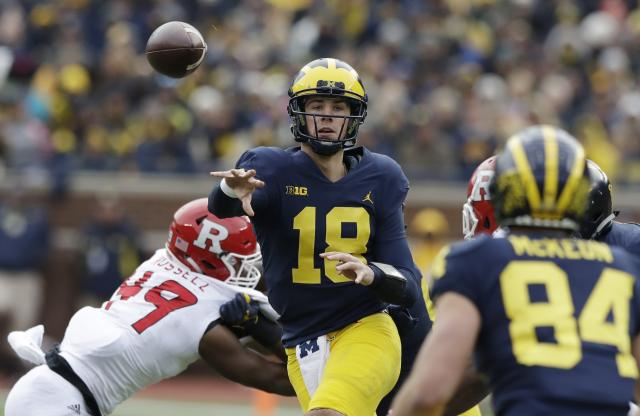"Michigan quarterback <a class=""link rapid-noclick-resp"" href=""/ncaaf/players/263464/"" data-ylk=""slk:Brandon Peters"">Brandon Peters</a> (18) throws while pressured by Rutgers linebacker <a class=""link rapid-noclick-resp"" href=""/ncaaf/players/239655/"" data-ylk=""slk:Brandon Russell"">Brandon Russell</a> (49) during the second half of an NCAA college football game, Saturday, Oct. 28,2017, in Ann Arbor, Mich. (AP Photo/Carlos Osorio)"