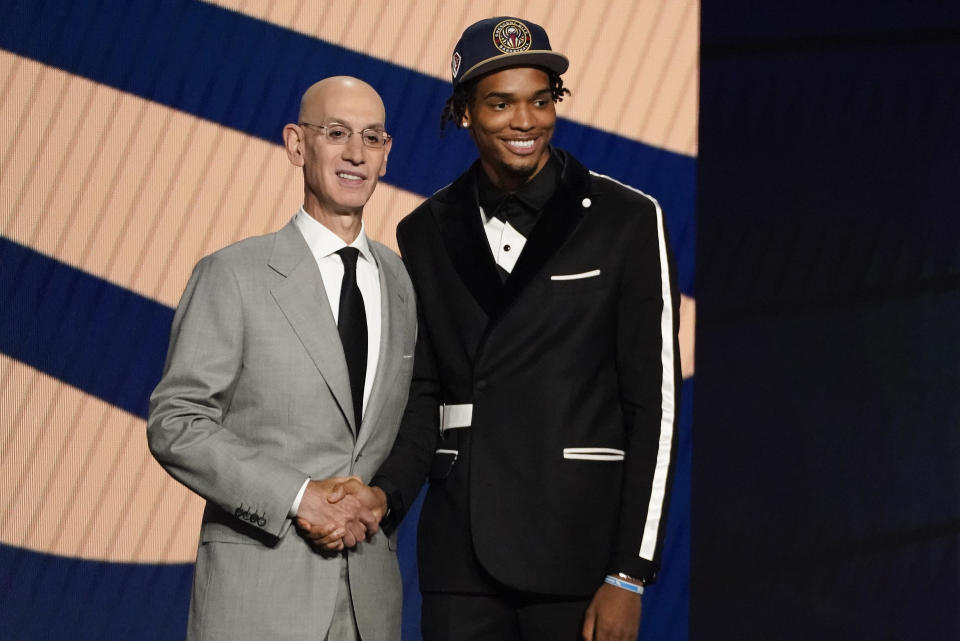 Ziaire Williams, right, poses for a photo with NBA Commissioner Adam Silver after being selected tenth overall by the New Orleans Pelicans during the NBA basketball draft, Thursday, July 29, 2021, in New York. (AP Photo/Corey Sipkin)