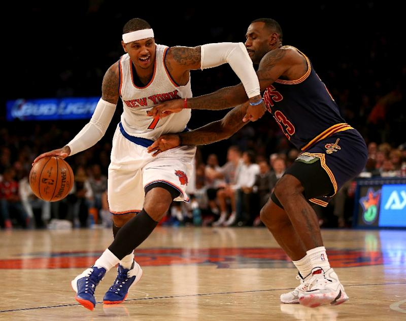 30a3fa21277d Carmelo Anthony of the New York Knicks tries to get around LeBron James of  the Cleveland