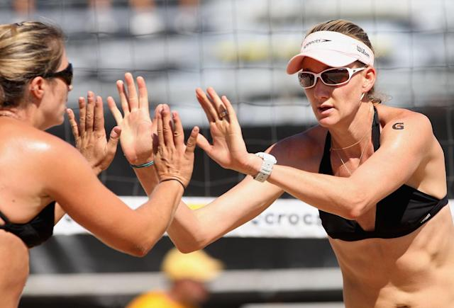 Kerri Walsh and Misty May-Treanor of USA celebrate a point during the round 3 match against Brazil in the AVP Crocs Tour World Challenge at the Westgate City Center on September 26, 2009 in Glendale, Arizona.
