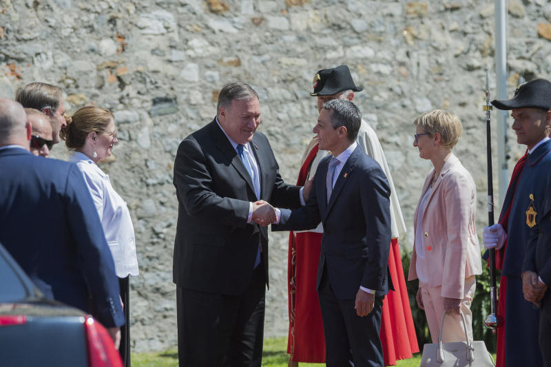 U.S. Secretary of State Mike Pompeo, left, and Swiss Foreign Minister Ignazio Cassis, right, shake hands during Pompeo's visit at the CastelGrande in Bellinzona, Switzerland, Sunday, 2 June 2019. (Samuel Golay/Keystone via AP)