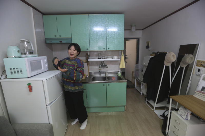 """Kim Da-hye, a 29-year-old South Korean, talks about her semi-basement apartment in Seoul, South Korea, Saturday, Feb. 15, 2020. For many South Koreans, the image of a cramped basement apartment portrayed in the Oscar-winning film """"Parasite"""" rings true, bringing differences in their social status to worldwide attention.(AP Photo/Ahn Young-joon)"""