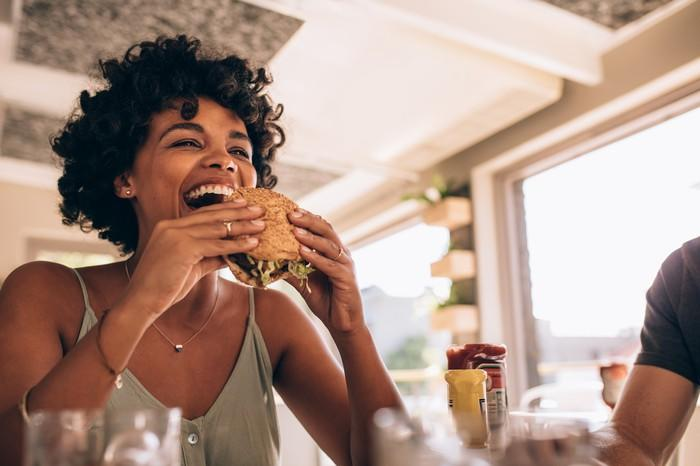 Woman eating a burger.