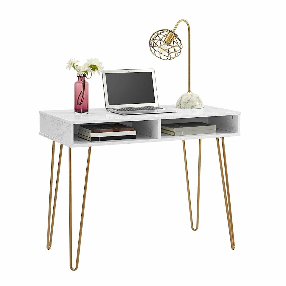 """<p>A modern desk with plenty of storage room for planners and notebooks, this marble and gold piece is just what your home workspace needs. Add your laptop, a table lamp, and some small decorative accents to finish the look.</p> <p><strong>To buy:</strong> $79; <a href=""""https://www.amazon.com/Novogratz-9618891COM-Computer-Storage-Marble/dp/B07FCTCSYW/ref=as_li_ss_tl?ie=UTF8&linkCode=ll1&tag=rshomezbynovogratzccalucchia0819-20&linkId=146f90f73a0b098376198eef3647b602&language=en_US"""" target=""""_blank"""">amazon.com</a>.</p>"""