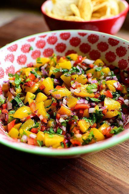"""<p>Give classic salsa a fruity twist by throwing in some peach. Chili powder and jalapeño balance things out beautifully.</p><p><strong><a href=""""https://thepioneerwoman.com/cooking/peach-salsa/"""" rel=""""nofollow noopener"""" target=""""_blank"""" data-ylk=""""slk:Get the recipe"""" class=""""link rapid-noclick-resp"""">Get the recipe</a>.</strong></p><p><a class=""""link rapid-noclick-resp"""" href=""""https://go.redirectingat.com?id=74968X1596630&url=https%3A%2F%2Fwww.walmart.com%2Fip%2FThe-Pioneer-Woman-Vintage-Floral-3-Piece-Serving-Bowl-Set%2F115837521&sref=https%3A%2F%2Fwww.thepioneerwoman.com%2Ffood-cooking%2Fmeals-menus%2Fg36004463%2Fmemorial-day-appetizers%2F"""" rel=""""nofollow noopener"""" target=""""_blank"""" data-ylk=""""slk:SHOP SERVING BOWLS""""><strong>SHOP SERVING BOWLS</strong></a></p>"""
