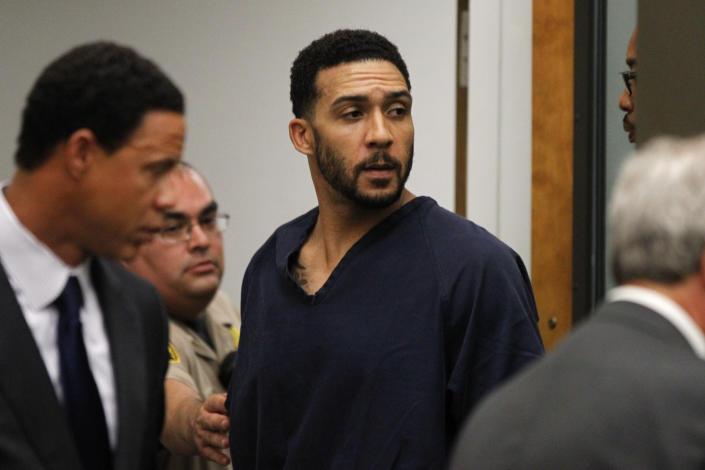 Former NFL football player Kellen Winslow Jr., center, leaves his arraignment Friday, June 15, 2018, in Vista, Calif. The former tight end was arrested Thursday on charges of rape and other sex crimes, the day he was to appear in court on an unrelated burglary charge. (Hayne Palmour/San Diego Union-Tribune via AP, Pool)