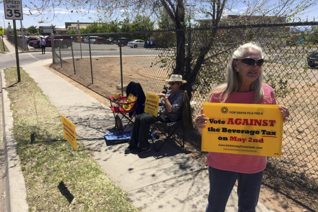 Coca-Cola Bottling Co. of Santa Fe Vice President Kathy Hart urges voters to reject a tax on sugary beverages outside a polling center in Santa Fe, N.M., on May 2, 2017. (Photo: Morgan Lee/AP)