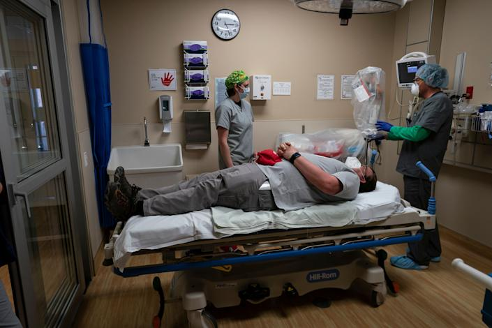 On April 23, medical workers at Kayenta Health Center on the Navajo Nation reservation prepare to practice with a new intubation shield to use when intubating patients. (Photo: ASSOCIATED PRESS)