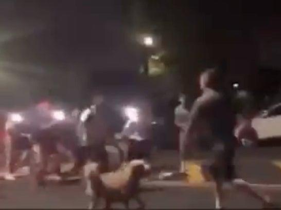 A group of teenagers confronts an off-duty New York firefighter who is out walking his dog in Queens. The teens allegedly attacked the firefighter before being scared off by an ambulance.  (screengrab)