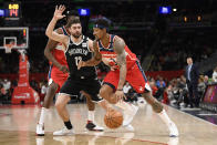 Washington Wizards guard Bradley Beal (3) dribbles next to Brooklyn Nets forward Joe Harris (12) during the first half of an NBA basketball game, Saturday, Feb. 1, 2020, in Washington. (AP Photo/Nick Wass)