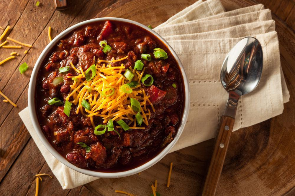 """<p>The quintessential make-ahead freezer meal to cure the weeknight blues is a piping hot pot of chili. It is super simple to prepare and you can add or omit any flavors or ingredients to customize your creation. Not only is it flavorful and rustic, but the <a href=""""https://www.thedailymeal.com/foods-pregnant-women-need-to-eat/slide-13?referrer=yahoo&category=beauty_food&include_utm=1&utm_medium=referral&utm_source=yahoo&utm_campaign=feed"""">generous amount of fiber in beans</a> makes chili incredibly filling and satisfying. For a low-maintenance dinner, try this <a href=""""https://www.thedailymeal.com/recipes/instant-pot-beef-chili-recipe?referrer=yahoo&category=beauty_food&include_utm=1&utm_medium=referral&utm_source=yahoo&utm_campaign=feed"""">instant pot beef chili recipe</a>, and feel free to adjust the spice level to your liking.</p>"""