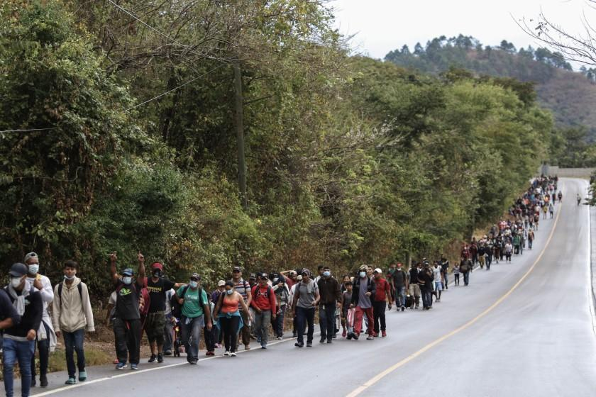 Migrants hoping to reach the U.S. border walk alongside a highway in Chiquimula, Guatemala, Saturday, Jan. 16, 2021. Honduran migrants pushed their way into Guatemala Friday night without registering, a portion of a larger migrant caravan that had left the Honduran city of San Pedro Sula before dawn, Guatemalan authorities said. (AP Photo/Delmer Martinez)
