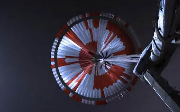 An image captured by the rover looking up its parachute during the descent - GETTY IMAGES