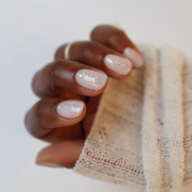 """<p>Adding just a touch of glitter down the centre of the nail gives the appearance of longer nails, instantly.</p><p><a href=""""https://www.instagram.com/p/B3ru5qAHeDS/"""" rel=""""nofollow noopener"""" target=""""_blank"""" data-ylk=""""slk:See the original post on Instagram"""" class=""""link rapid-noclick-resp"""">See the original post on Instagram</a></p>"""