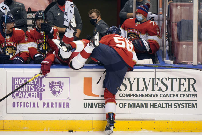 Florida Panthers defenseman Noah Juulsen (58) sends Detroit Red Wings right wing Bobby Ryan over the wall during the first period of an NHL hockey game, Sunday, Feb. 7, 2021, in Sunrise, Fla. (AP Photo/Wilfredo Lee)