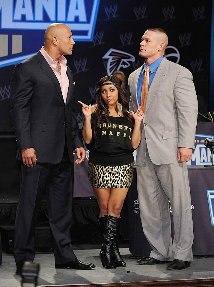 """Nicole """"Snooki"""" Polizzi hit up the WrestleMania XXVII press conference in New York City Wednesday with towering ex-wrestlers Dwayne """"The Rock"""" Johnson and John Cena. The """"Jersey Shore"""" star also made headlines this week when it was revealed she was paid $32,000 to speak at Rutgers University in New Jersey on Thursday. The reality starlet's topics of conversation? Her hair pouf, her """"career,"""" and her """"GTL"""" (Gym, Tan, Laundry) lifestyle. Snooki's golden advice to students: """"Study hard, but party harder."""" Dimitrios Kambouris/<a href=""""http://www.wireimage.com"""" target=""""new"""">WireImage.com</a> - March 30, 2011"""