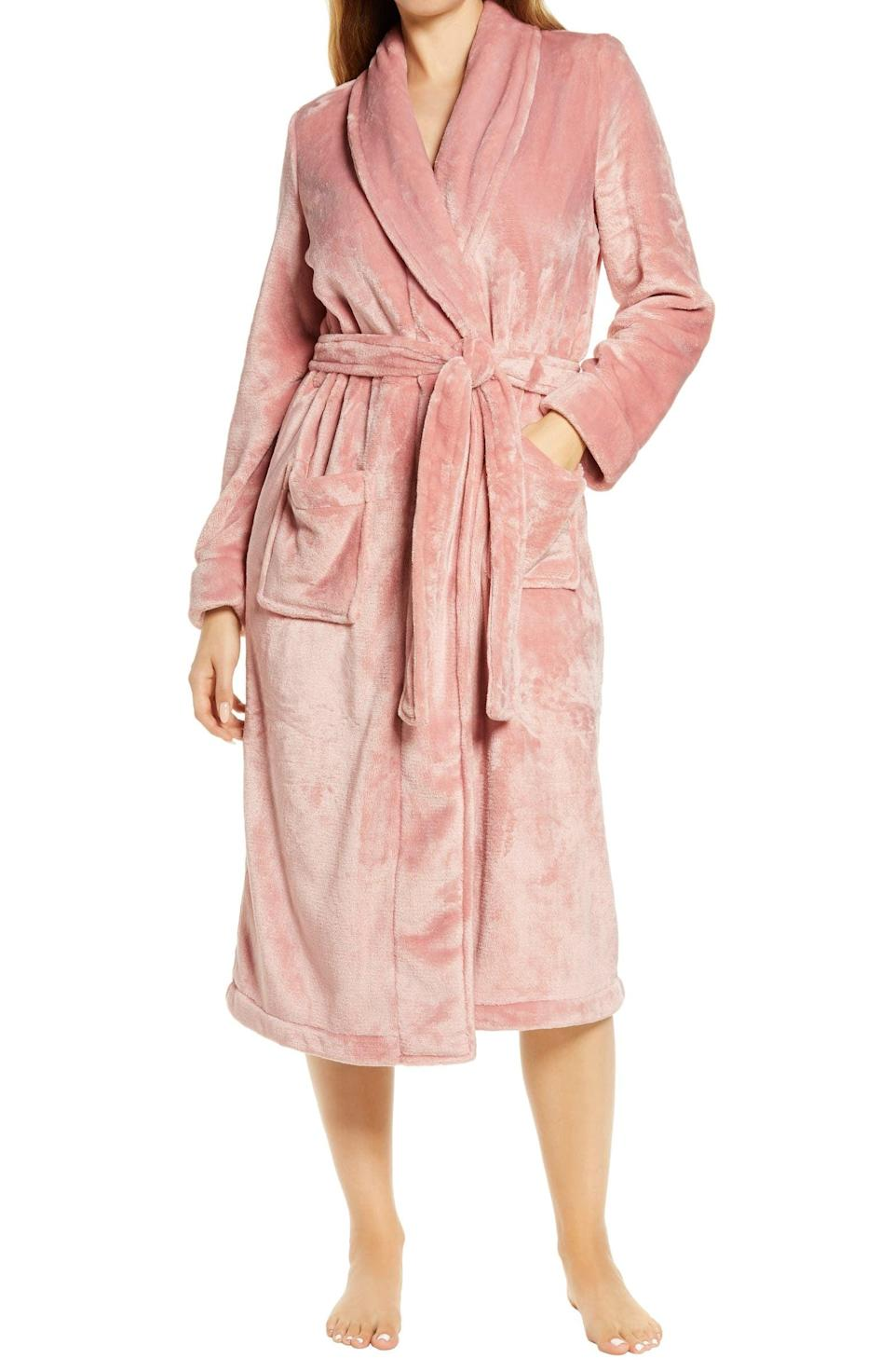 <p>Transport them to luxurious hotel with this stylish and plush <span>Nordstrom Bliss Plush Robe</span> ($69). The high-shine fleece is not only ultra-comfortable but looks like a million bucks! It comes in pink, white, and grey.</p>