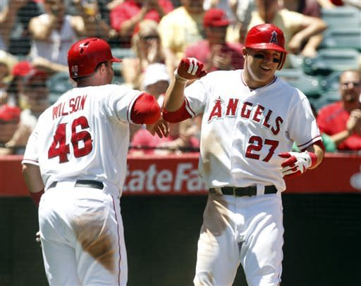 Angels beat Royals 11-6 behind Weaver, Trout
