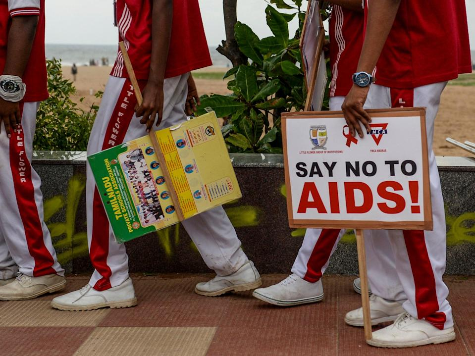 <p>Schoolchildren in Chennai take part in World Aids Day last year</p> (AFP via Getty Images)