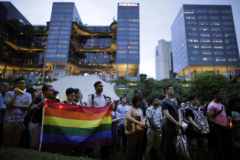People gather at a park in Singapore for a vigil in remembrance of the Orlando shooting victims on 14 June, 2016. (AP file photo)