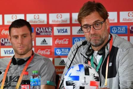 86192981_Liverpool FC coach Jurgen Klopp R and midfielder James Milner L give a press conference.jpg