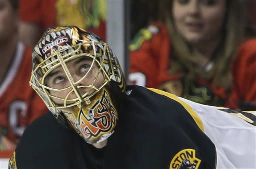 Boston Bruins goalie Tuukka Rask (40) checks the scoreboard in the first period against the Chicago Blackhawks during Game 5 of the NHL hockey Stanley Cup Finals, Saturday, June 22, 2013, in Chicago. (AP Photo/Nam Y. Huh)