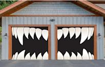 """<p>This <span>Scary Teeth Garage Door Mural</span> ($300) is certainly one way to greet people, and the best part is you can safely take it down and reuse it next <a class=""""link rapid-noclick-resp"""" href=""""https://www.popsugar.com/Halloween"""" rel=""""nofollow noopener"""" target=""""_blank"""" data-ylk=""""slk:Halloween"""">Halloween</a>! Unlike other stick-on murals, this garage decor is made with flexible vinyl material, so it moves with the garage door in one fluid motion. </p>"""