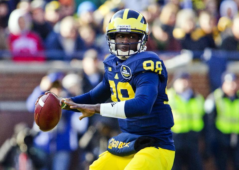 Michigan quarterback Devin Gardner (98) throws a pass in the first quarter of an NCAA college football game with Ohio State in Ann Arbor, Mich., Saturday, Nov. 30, 2013. (AP Photo/Tony Ding)