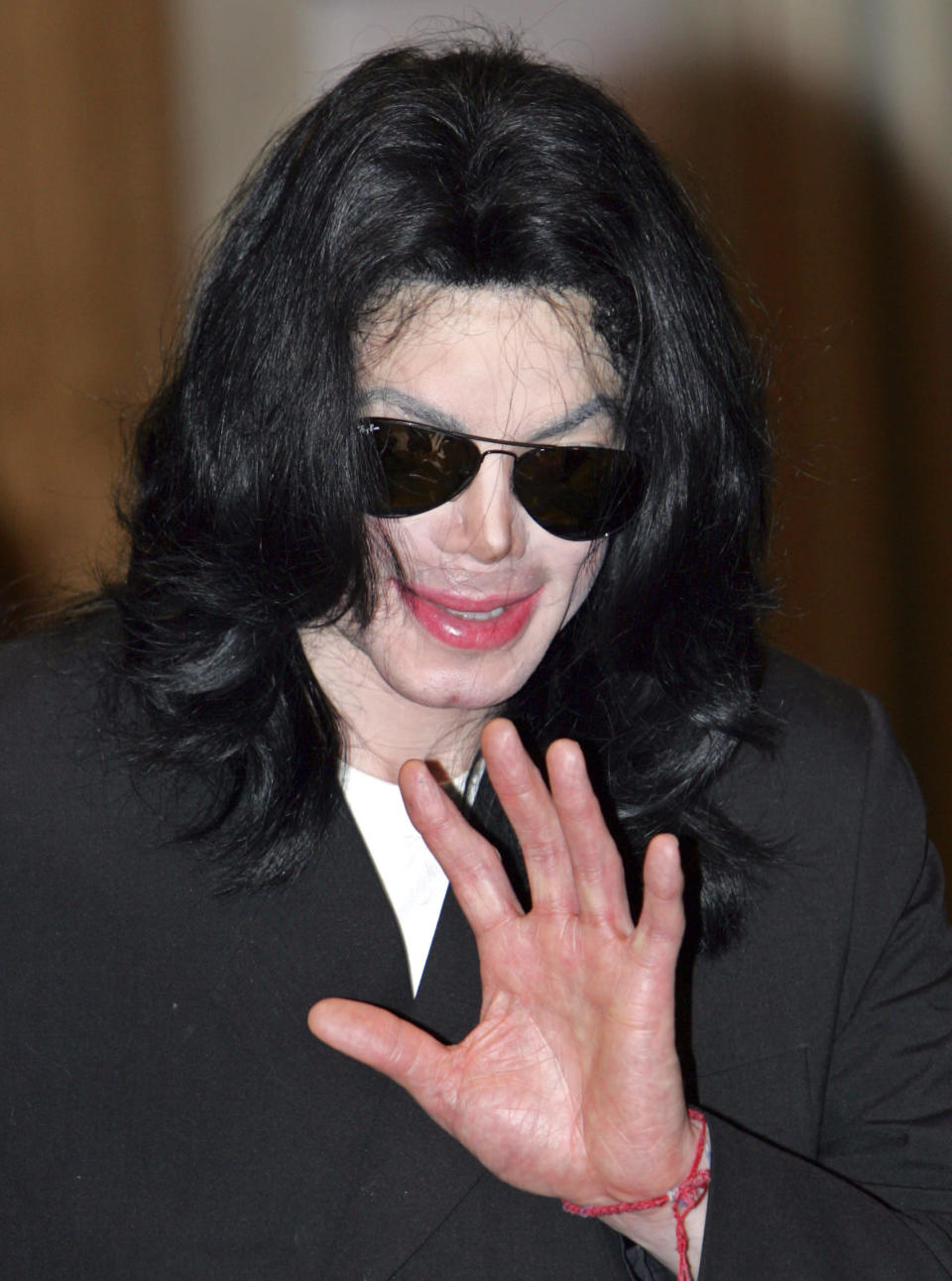 FILE - Michael Jackson waves in Tokyo in this Sunday, May 28, 2006, file photo. Jackson's Neverland Ranch has found a new owner in billionaire businessman Ron Burkle. Burkle's spokesman said in an email Thursday, Dec. 24, 2020, that Burkle bought the 2,700-acre property near Santa Barbara, California. (AP Photo/Shizuo Kambayashi, File)