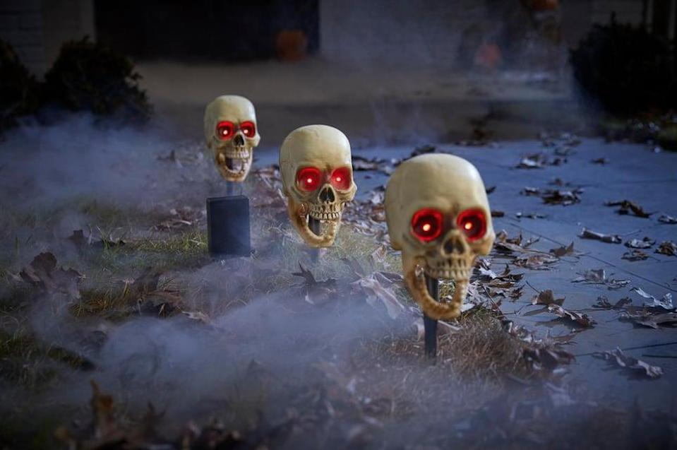 <p>Give your front door walkway major skeletal vibes with these <span>Animated LED Skeleton Halloween Pathway Markers</span> ($25). The red eyed characters whisper petrifying phrases sure to cast goosebumps on anyone who dares to walk by. </p> <p><br></p>