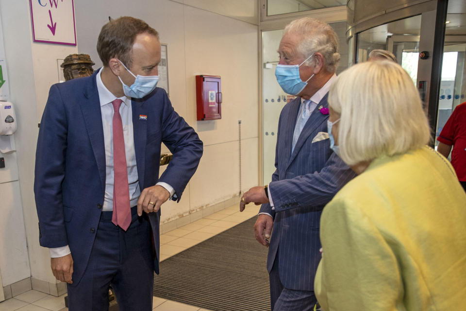 Britain's Health Secretary Matt Hancock (L) speaks with Britain's Prince Charles, Prince of Wales (2nd R), during a visit to Chelsea & Westminster Hospital in London on June 17, 2021. (Photo by Steve REIGATE / POOL / AFP) (Photo by STEVE REIGATE/POOL/AFP via Getty Images)