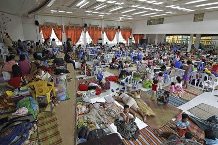 People take shelter inside a evacuation centre after evacuating from their homes due to super-typhoon Hagupit in Surigao city, southern Philippines December 5, 2014. REUTERS/Stringer