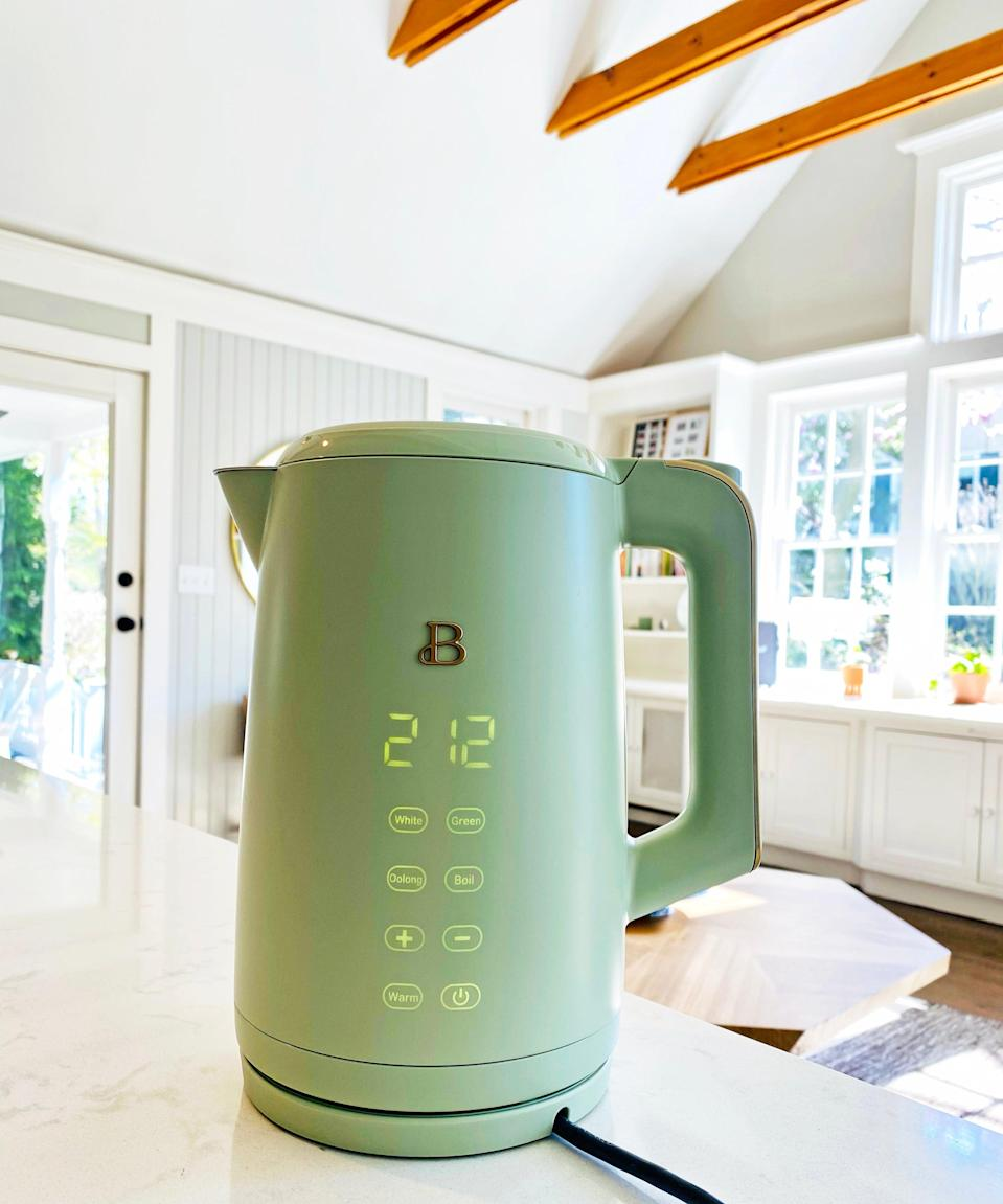 "<h2>Beautiful By Drew Barrymore One-Touch Electric Kettle</h2><br>""This pretty electric kettle is the product of <a href=""https://www.refinery29.com/en-us/2021/03/10372426/drew-barrymore-beautiful-kitchenware-launch-2021"" rel=""nofollow noopener"" target=""_blank"" data-ylk=""slk:Drew Barrymore's newest Walmart venture"" class=""link rapid-noclick-resp"">Drew Barrymore's newest Walmart venture</a>, a cookware collection she's aptly dubbed <a href=""https://www.walmart.com/cp/beautiful-by-drew-barrymore/6177615"" rel=""nofollow noopener"" target=""_blank"" data-ylk=""slk:Beautiful"" class=""link rapid-noclick-resp"">Beautiful</a>. I snagged one for my kitchen after we covered its launch and am delighted by the dreamy sight of it atop my counter (as well as how lightning-fast it boils up a pot full of water). This pistachio-green piece only costs $40, if you can believe it — and, on top of its luxe aesthetics, it also boasts high-tech capabilities with a digital touchscreen that lights up when you need to use it and turns off when you don't. This could, in all honesty, be one of the best things I've purchased all year. It just dropped in cool sesame-black, oyster-gray, and icing-white colorways as well."" <em>– Elizabeth Buxton, Editor</em><br><br><em>Shop <strong><a href=""https://www.walmart.com/ip/Beautiful-1-7L-One-Touch-Electric-Kettle-Sage-Green-by-Drew-Barrymore/587407613"" rel=""nofollow noopener"" target=""_blank"" data-ylk=""slk:Walmart"" class=""link rapid-noclick-resp"">Walmart</a></strong></em><br><br><strong>Beautiful</strong> 1.7L One-Touch Electric Kettle, $, available at <a href=""https://go.skimresources.com/?id=30283X879131&url=https%3A%2F%2Fwww.walmart.com%2Fip%2FBeautiful-1-7L-One-Touch-Electric-Kettle-Sage-Green-by-Drew-Barrymore%2F587407613"" rel=""nofollow noopener"" target=""_blank"" data-ylk=""slk:Walmart"" class=""link rapid-noclick-resp"">Walmart</a>"