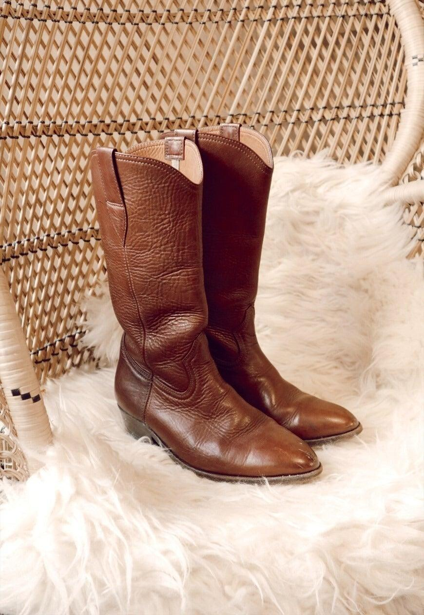 """<br><br><strong>Strange Ray Vintage</strong> Tan Brown Genuine Leather Cowboy Boot, $, available at <a href=""""https://marketplace.asos.com/listing/boots/georgia-girl--womens-tan-brown-genuine-leather-cowboy-boot/6596924?index=Products&objectID=6596924&fromSearchTerm=cowboy%20boots"""" rel=""""nofollow noopener"""" target=""""_blank"""" data-ylk=""""slk:asos marketplace"""" class=""""link rapid-noclick-resp"""">asos marketplace</a>"""