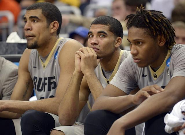Colorado players, from left, Josh Scott, Xavier Talton and Xavier Johnson sit on the bench during the second half in a second-round game in the NCAA college basketball tournament against Pittsburgh Thursday, March 20, 2014, in Orlando, Fla. Pittsburgh won 77-48. (AP Photo/Phelan M. Ebenhack)