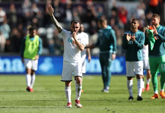 "Soccer Football - Premier League - Swansea City vs Stoke City - Liberty Stadium, Swansea, Britain - May 13, 2018 Swansea City's Angel Rangel salutes their fans after the match as they are relegated from the Premier League Action Images via Reuters/Peter Cziborra EDITORIAL USE ONLY. No use with unauthorized audio, video, data, fixture lists, club/league logos or ""live"" services. Online in-match use limited to 75 images, no video emulation. No use in betting, games or single club/league/player publications. Please contact your account representative for further details."