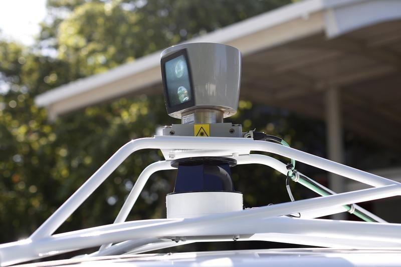 A sensor is seen spinning atop a Google self-driving vehicle before a presentation at the Computer History Museum in Mountain View, California
