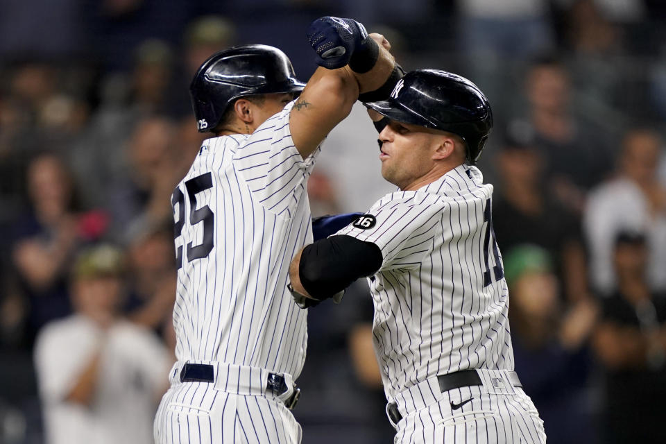 New York Yankees' Brett Gardner, right, celebrates with Gleyber Torres after hitting a three-run home run off Cleveland Indians relief pitcher Nick Wittgren during the seventh inning of a baseball game Friday, Sept. 17, 2021, in New York. (AP Photo/John Minchillo)