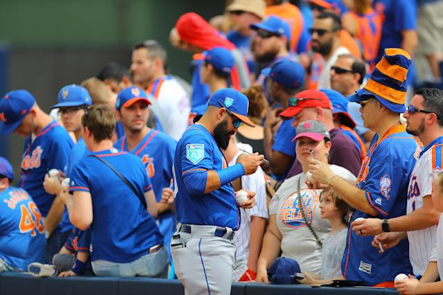 <p>New York Mets minor leaguer Luis Guillorme signs for fans before the baseball game against the Houston Astros at the Ballpark of the Palm Beaches in West Palm Beach, Fla., on Feb. 26, 2018. (Photo: Gordon Donovan/Yahoo News) </p>