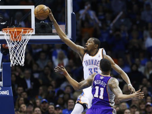 Oklahoma City Thunder forward Kevin Durant (35) goes up for a dunk in front of Phoenix Suns forward Markeiff Morris (11) in the second quarter of an NBA basketball game in Oklahoma City, Friday, Feb. 8, 2013. (AP Photo/Sue Ogrocki)