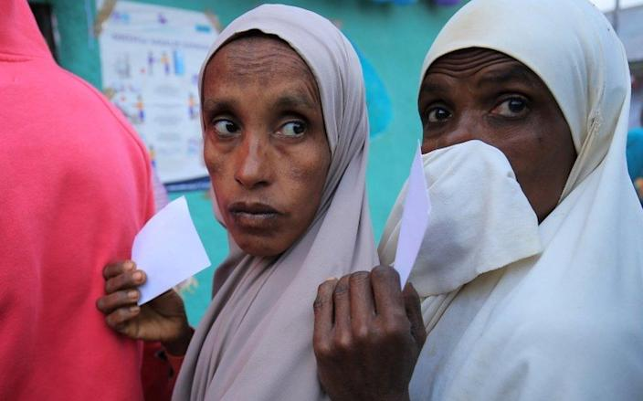 Voters queue up at a polling station during the Ethiopian parliamentary and regional elections, in Beshasha, Ethiopia, June 21, 2021