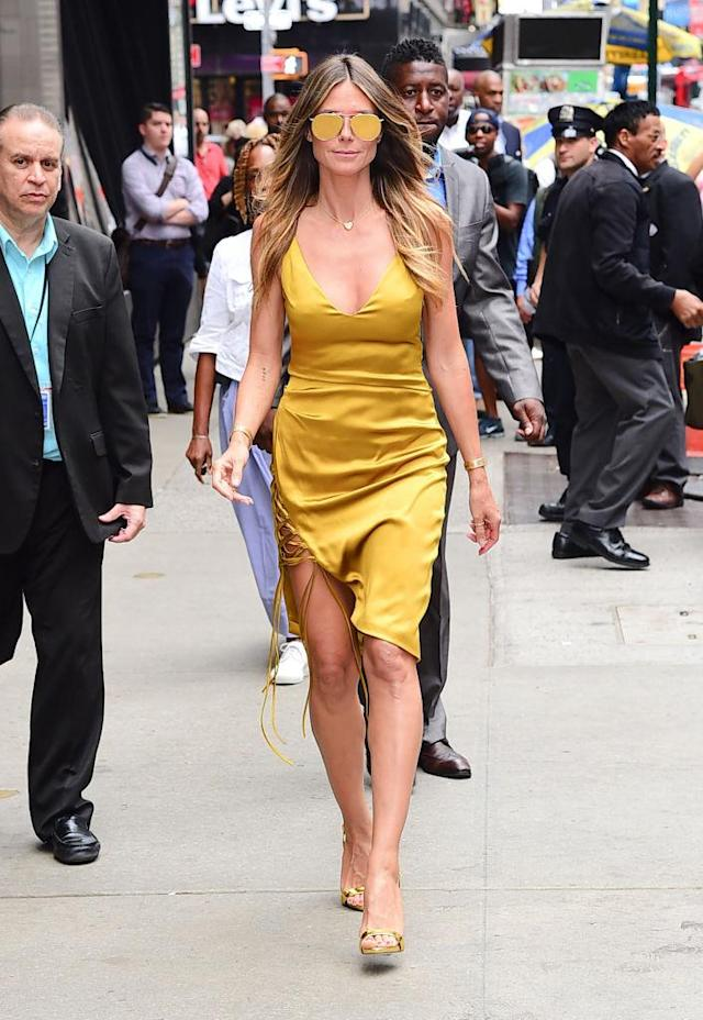 Heidi Klum wore a gold dress to an appearance in New York City. (Photo by Raymond Hall/GC Images)