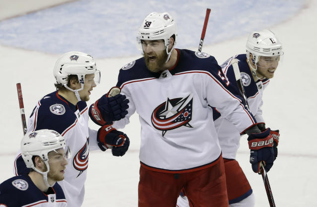 Columbus Blue Jackets' Artemi Panarin, second from left, celebrates his goal with teammate David Savard (58) during the third period of an NHL hockey game against the San Jose Sharks, Sunday, March 4, 2018, in San Jose, Calif. Columbus won 4-2. (AP Photo/Marcio Jose Sanchez)